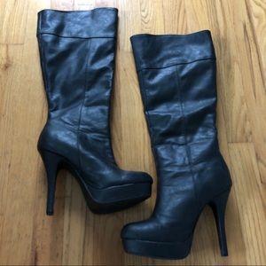 Black platform knee-high boots